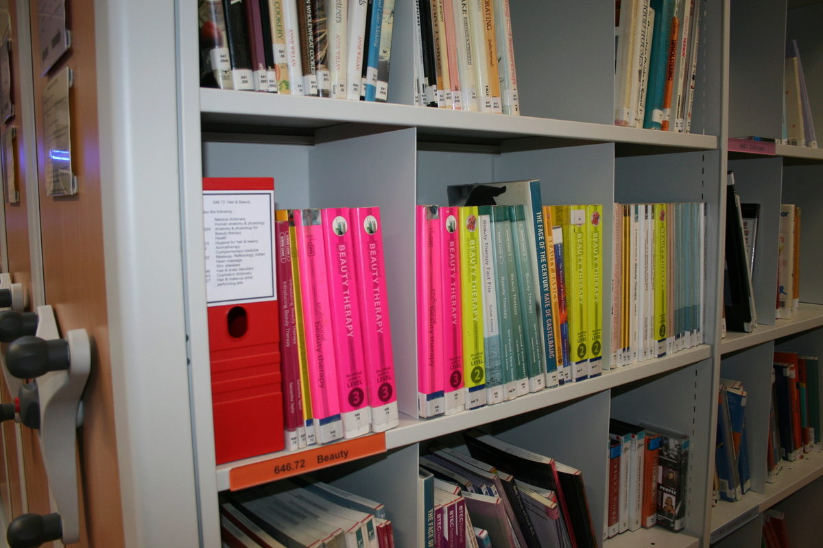 Robust, multi-purpose mobile shelving systems, customised to fit the library's décor.